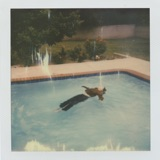 """The album art for """"dead girl in the pool. - Single"""" by girl in red"""